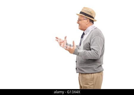 Studio shot of a senior gentleman explaining something isolated on white background - Stock Photo
