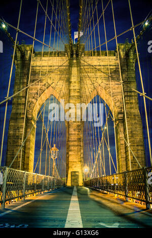 Night view of beautiful Brooklyn Bridge in New York City - Stock Photo
