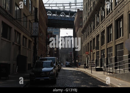 View looking down Plymouth Street toward the Manhattan Bridge and the Brooklyn Bridge in DUMBO, Brooklyn - Stock Photo