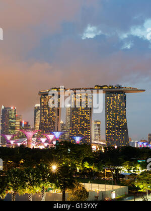 South East Asia, Singapore, Gardens by the Bay, Supertree Grove and Marina Bay Sands Hotel and Casino - Stock Photo