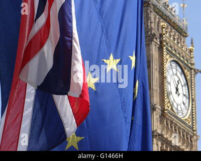 London, UK. 8th May, 2016. UK and EU flags in front of Big-Ben, Parliament square, London, UK. 8 may 2016 - Stock Photo