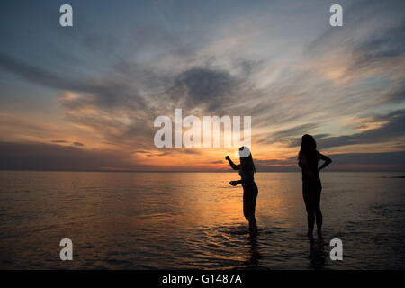 Aberystwyth Wales Uk, Sunday 08 May 2016  UK Weather :   At the end of the warmest day if the year so far, two women - Stock Photo