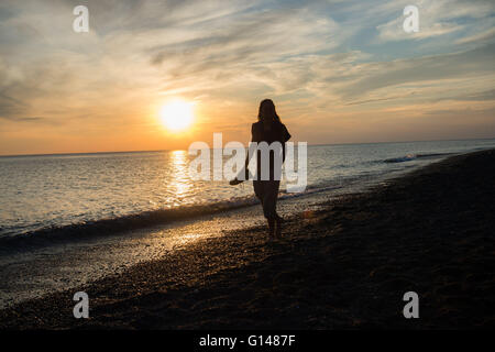 Aberystwyth Wales Uk, Sunday 08 May 2016  UK Weather :   At the end of the warmest day if the year so far, a woman - Stock Photo