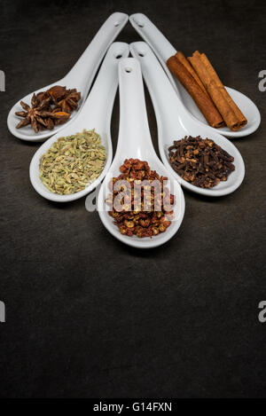 Five Spice with Szechuan Peppercorns Focus in Foreground Spoon - Stock Photo