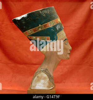 Painted limestone bust of the Ancient Egyptian queen Nefertiti. This bust was found in Amarna and is now held in - Stock Photo
