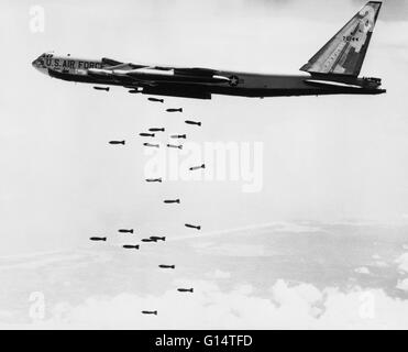 Undated image of a B-52 bomber dropping conventional bombs over Vietnam. - Stock Photo