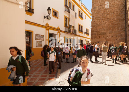 Spanish school girls in Marbella, Spain leaving school, Marbella, Andalusia, Spain Europe - Stock Photo