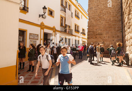 Spanish school boys leaving school, Marbella, Andalusia, Spain Europe - Stock Photo
