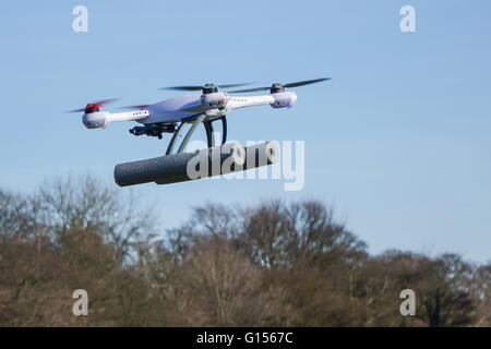 Blade 50QX hobby drone flying in a park setting near trees with copy space and no people - Stock Photo