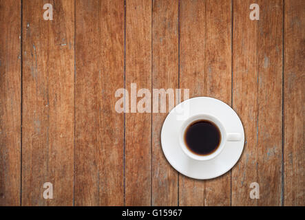 Top view of white coffee cup on wooden background, stock photo - Stock Photo