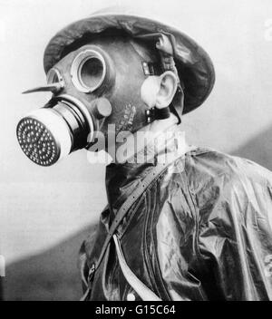 British soldier wearing a gas mask and protective suit in 1940, during the second World War. - Stock Photo