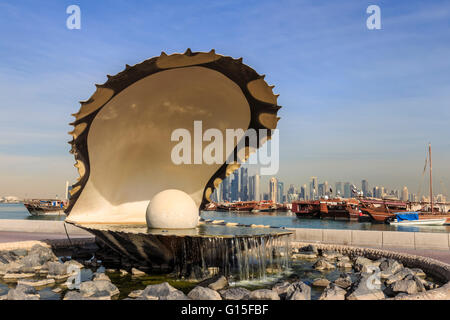 Pearl Monument with moored dhows and modern city skyline of West Bay, from Al-Corniche, Doha, Qatar, Middle East - Stock Photo