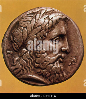 Greek god Zeus depicted on an ancient Greek coin from Elis. Zeus is the 'father of Gods and men' who rules the Olympians - Stock Photo