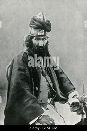 A Persian Dervish. The old dervish's huge turban of green cloth (the color of the Prophet) is surmounted by tufts - Stock Photo