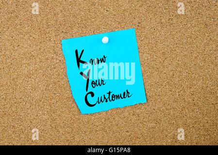 Business Acronym KYC Know Your Customer written on blue paper note pinned on cork board with white thumbtack, copy - Stock Photo