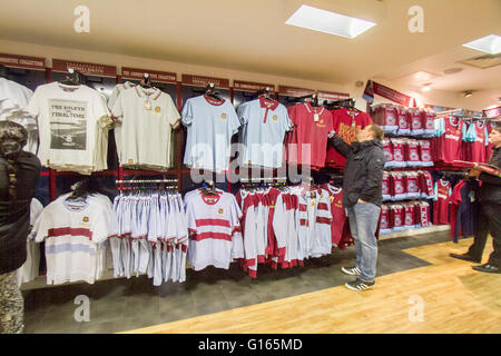 Upton Park London, UK. 10th May.  A fan looking at memorabilia shirts inside the club store as West Ham United Football - Stock Photo