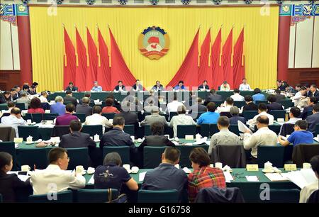 Beijing, China. 10th May, 2016. Yu Zhengsheng(5th L back), chairman of the National Committee of the Chinese People's - Stock Photo
