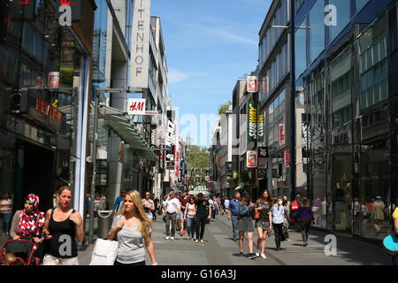 look into the famous shopping street Hohe Straße, in Cologne, Germany - Stock Photo