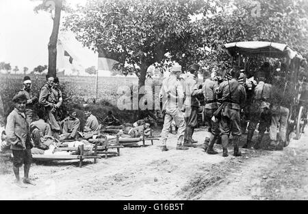 Austrian soldiers with an ambulance in the road during World War I. The Austro-Hungarian Army was the ground force - Stock Photo