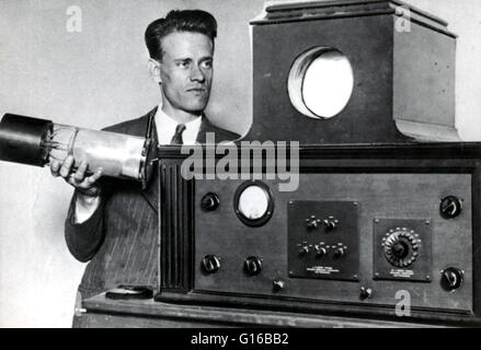 Captioned: 'Farnsworth holding his dissector tube, and displaying his revolutionary new television, San Francisco, - Stock Photo