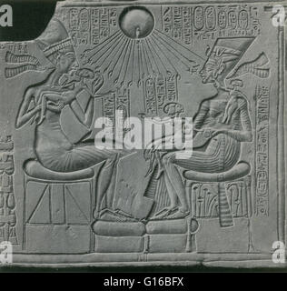 Caption: 'Sunk-relief depicting Egyptian pharaoh Akhenaton, his wife Nefertiti, and three of their daughters, with - Stock Photo
