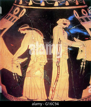 Priestesses prepare two bulls for sacrifice to the gods. They have washed the animals and are tying flowers around - Stock Photo