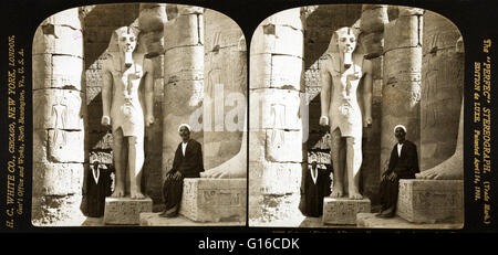 Stereograph from 1908 entitled: 'Colossal statue of Ramses II among the columns of the Temple of Luxor, Egypt.' - Stock Photo