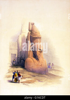 Entitled: 'One of two colossal statues of Rameses II entrance to the Temple of Luxor.' The Luxor Temple is a huge - Stock Photo