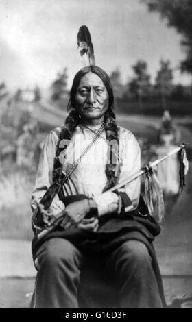 Sitting Bull, holding calumet, photographed by Orlando Scott, 1881. Sitting Bull (1831 - December 15, 1890) was - Stock Photo