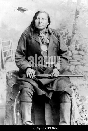 Spotted Elk holding peace pipe, no date or photographer credited. Spotted Elk (1826 - December 29, 1890) was a chief - Stock Photo