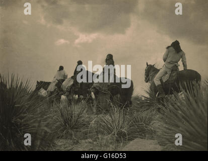 Entitled: 'Before the storm' photographed by Edward S. Curtis, December 19, 1906. Four Apaches on horseback under - Stock Photo