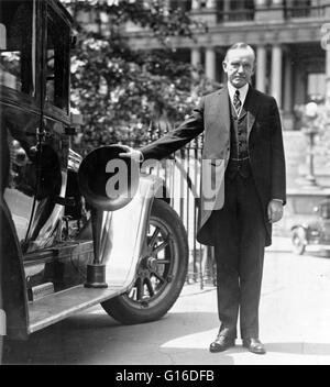 President Coolidge with his right hand on piece of radio equipment used on automobiles during the campaign, 1924. - Stock Photo