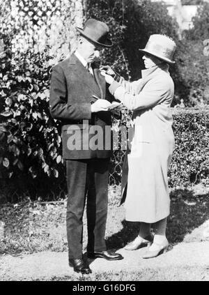 Mrs. Calvin Coolidge enrolls the President in the American Red Cross, October 29, 1924. John Calvin Coolidge, Jr. - Stock Photo