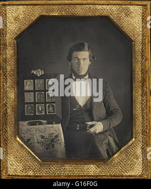 Daguerreotype portrait of an unidentified daguerreotypist who is displaying samples of his work. Taken in America, - Stock Photo