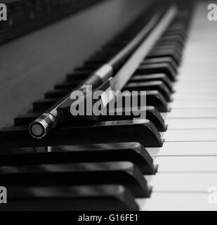 Bow on Piano Keys - Stock Photo