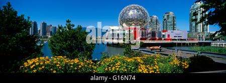 Vancouver, BC, British Columbia, Canada - Telus World of Science (aka Science World) and City Skyline at False Creek - Stock Photo