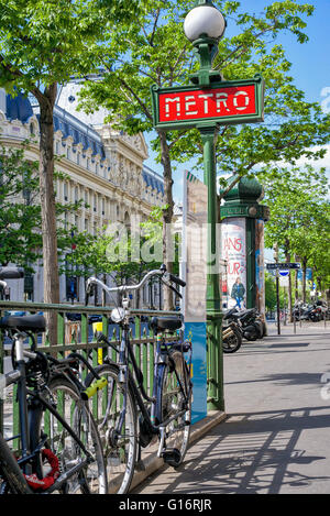 A bicycle chained to a railing on a Parisian sunny street. - Stock Photo