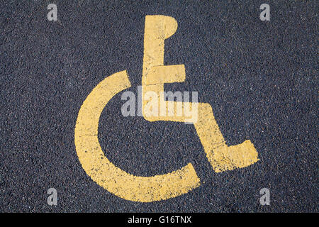 The Disabled symbol painted on a Road. - Stock Photo