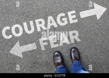Courage and fear risk safety future strength strong business man concept businessman finances - Stock Photo