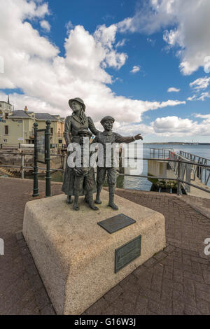 Cobh, Ireland: Statue on the waterfront of Annie Moore, who was the first person to be admitted to the United States of America.