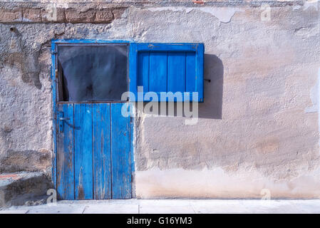 an old, wooden, blue stable door - Stock Photo