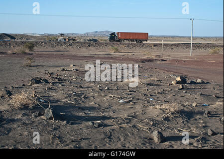 Heavy goods vehicle plying on a road in the Afar desert ( Ethiopia) - Stock Photo