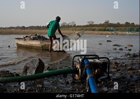 Electric water pump + fisherman. Lake Ziway ( Ethiopia) - Stock Photo