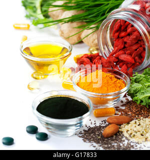 Alternative natural medicine. Dietary supplements. Spirulina, turmeric  and organic oil on white background. Superfood, - Stock Photo