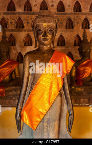 ancient standing buddha statue - Stock Photo