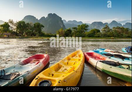 kayak boats in Nam Song river at Vang Vieng, Laos - Stock Photo