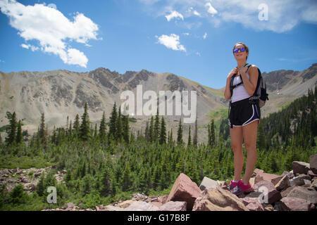 Hiker enjoying view on rocks, Aspen, Colorado - Stock Photo