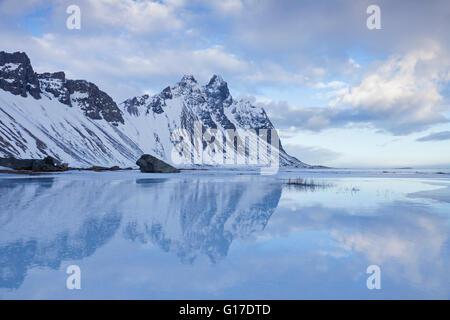 Vestrahorn mountain in Stokksnes, part of the mountains Klifatindur in winter, Iceland - Stock Photo