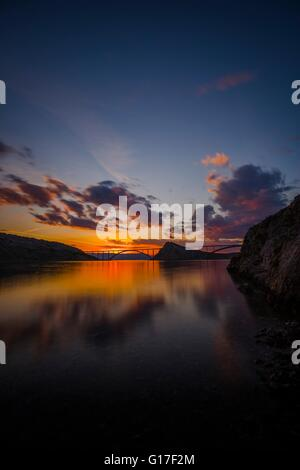 Bridge mainland to island Krk in Croatia in sunset vertical format waterscape twilight picturesque colorful landscape - Stock Photo