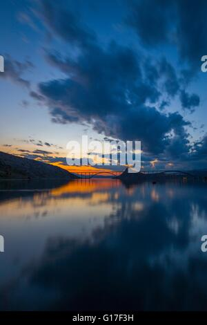 Bridge mainland to island Krk Croatia in sunset quiet quietness peaceful smoothness romantic twilight picturesque - Stock Photo